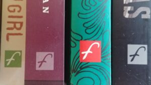 Four book spines featuring the Freehand logo