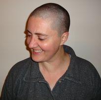 Ellen Kartz headshot, looking down and smiling