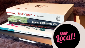 """Image of Alberta books stacked on a laptop, with the words """"Shop local!"""" overlaid, indicating that this article is part of the """"Shop Local"""" column."""
